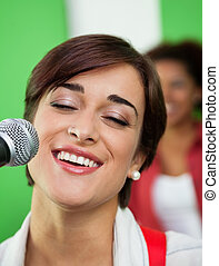 Woman Singing While Closing Eyes