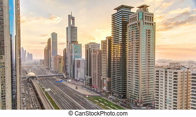 Downtown Dubai towers in the evening timelapse Aerial view...