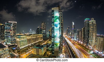 Downtown Dubai towers night timelapse. Aerial view of Sheikh Zayed road with skyscrapers.