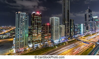 Downtown Dubai towers night timelapse. Aerial view of Sheikh...