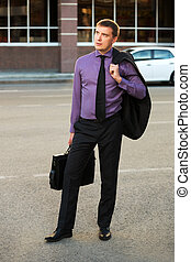 Young business man on the city street