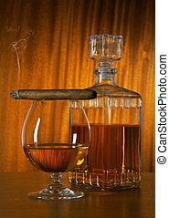 Glass of whisky with cigar - Glass and decanter of whisky...