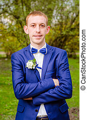 groom in a blue suit - Handsome confident groom in a blue...