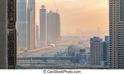 Downtown Dubai towers in the evening timelapse. Aerial view...