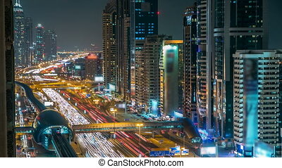 Downtown Dubai towers night timelapse Aerial view of Sheikh...