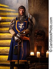 Medieval knight on guard in ancient castle interior