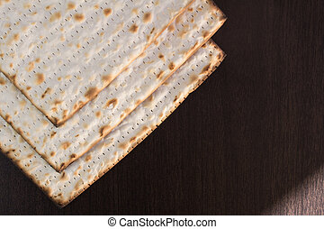 Matzo on brown background