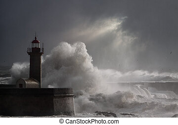 Dramatic seascape with stormy waves over lighthouse -...