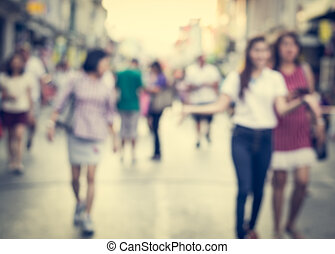 Blurred people walking on the street of old town