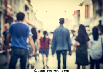 Blurred people walking on the street of old town - Blurred...