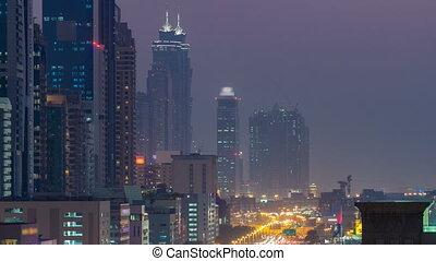 Downtown Dubai towers day to night timelapse. Aerial view of...