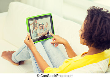 happy african american woman with tablet pc - people,...