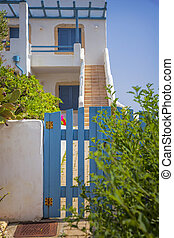 Blue gate in Greece - Image of residential house with blue...