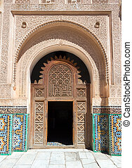 Madrasa door - MARRAKECH, MOROCCO - Entrance door to the...
