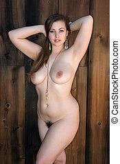 Curvy nude brunette