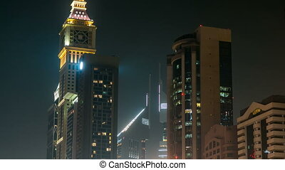 Downtown Dubai towers night timelapse. View of skyscrapers...