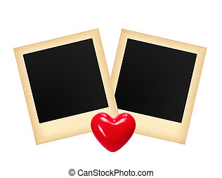 Two old photo papers card and red heart isolated on white...