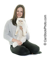 white persian cat and teenager in front of white background