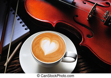 Coffee latte - Latte art and violin on wooden table