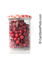 Glass full of red cranberries