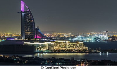 Dubai skyline with villas nad Burj Al Arab night timelapse....