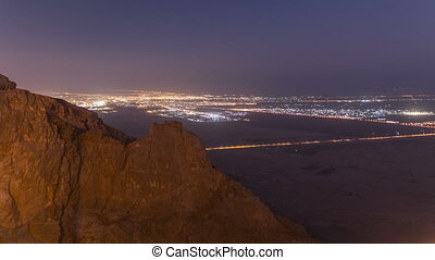 Day to night timelapse with rocks. Jebel Hafeet is a...