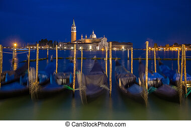 Gondolas in night time at the Piazza San Marco, Venice, Italy.