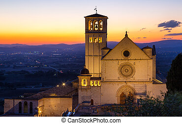 The Papal Basilica of St Francis of Assisi at sunset Assisi,...