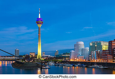 Colorful night scene of Rhein river at night in Dusseldorf -...