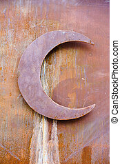 Rusty half moon on grunge wall