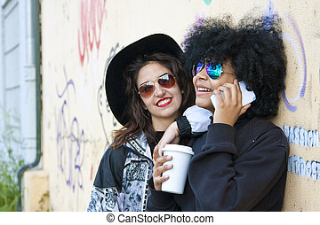 friends talking by mobile phone