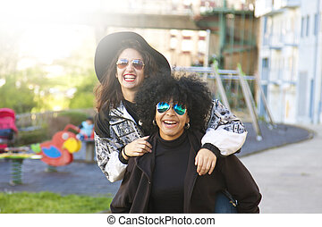 young friends having fun in the street