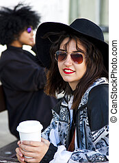 fashion girl drinking coffee on the street