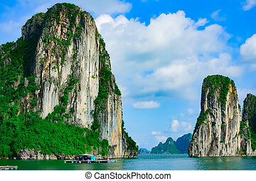Rock islands near floating village in Halong Bay
