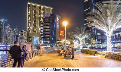 Run on promenade of Dubai Marina with view of Towers and...