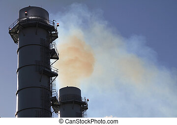 Smoke Stacks lit spewing pollution from Smokestack at power...