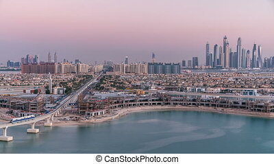 Jumeirah Palm island skyline day to night timelapse in...