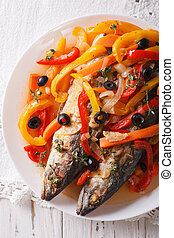 Escabeche of mackerel fish with vegetables close-up. vertical top view