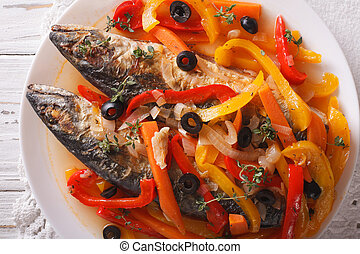 Escabeche of mackerel fish with vegetables close-up. horizontal top view