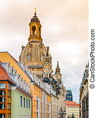 Dome of Dresden Frauenkirche behind buildings of Old Town,...