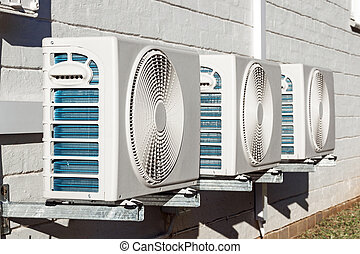 Three Newly Installed Airconditioning Units Mounted on Wall...