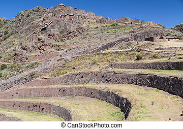 Inca agricultural terraces and village ruins in Pisaq, Peru...