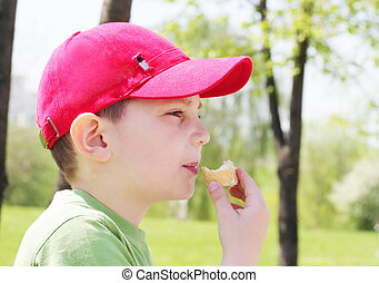 Boy eating ice-cream - Little boy eating ice-cream outdoors...