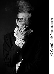 young man in glasses with cigarette