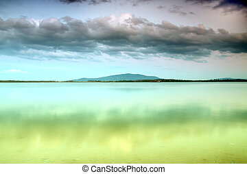 Beautiful summer landscape with cloudy sky, mountain and...