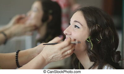 Make-up for photo session - Makeup artist apply the cream on...
