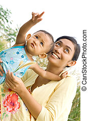 ethnic mother and toddler playing - asian ethnic mother and...