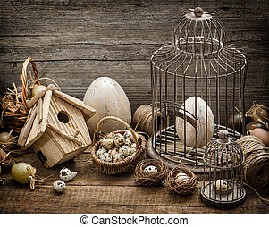 Easter decoration with eggs, birdhouse and birdcage...