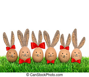 Funny bunnies easter eggs with big ears in green grass....