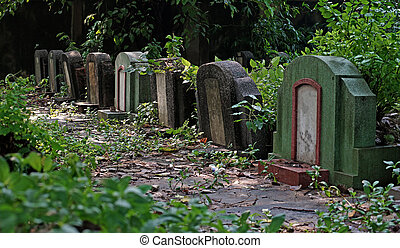 old tombstones and graveyards in abandoned chinese cemetery